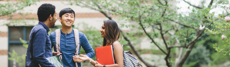 Three Students Talking on Campus