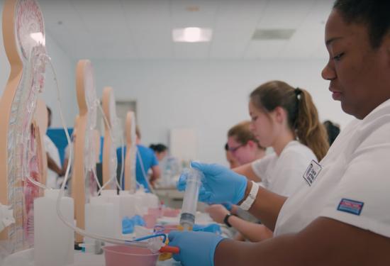 Nursing students practice essential skills.